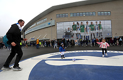 Fans play football outside the ground before the FA Cup fourth round match at the AMEX Stadium, Brighton.