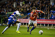 Nathaniel Chalobah and Diego Fabbrini during the Sky Bet Championship match between Reading and Birmingham City at the Madejski Stadium, Reading, England on 22 April 2015. Photo by Adam Rivers.