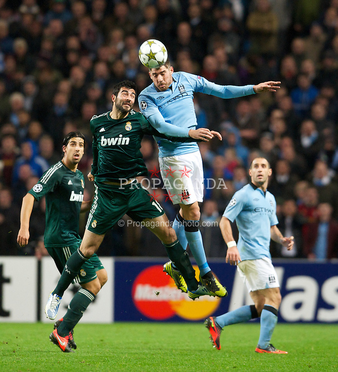 MANCHESTER, ENGLAND - Wednesday, November 21, 2012: Manchester City's Aleksandar Kolarov in action against Real Madird CF's Raul Albiol during the UEFA Champions League Group D match at the City of Manchester Stadium. (Pic by David Rawcliffe/Propaganda)