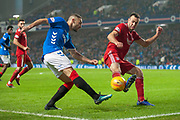 Eros Grezda (#35) of Rangers FC has his cross blocked by Andy Considine (#4) of Aberdeen FC during the Ladbrokes Scottish Premiership match between Rangers and Aberdeen at Ibrox, Glasgow, Scotland on 5 December 2018.