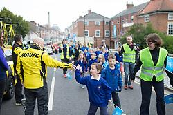 A young boy gives a high five to a Mavic neutral support mechanic before the Tour de Yorkshire - a 122.5 km road race, between Tadcaster and Harrogate on April 29, 2017, in Yorkshire, United Kingdom.