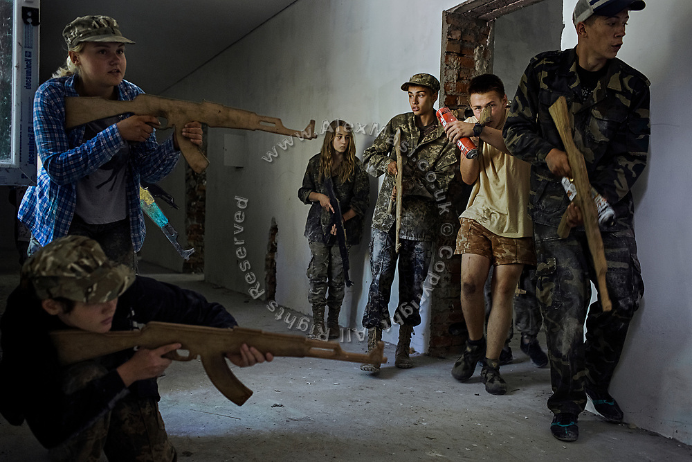 Youngsters participating to the ultra-nationalistic Azovets children's camp are taking part to a tactical training with dummy weapons in an abandoned building near the village of Buzova, 30 km west of Kiev, the capital of Ukraine.
