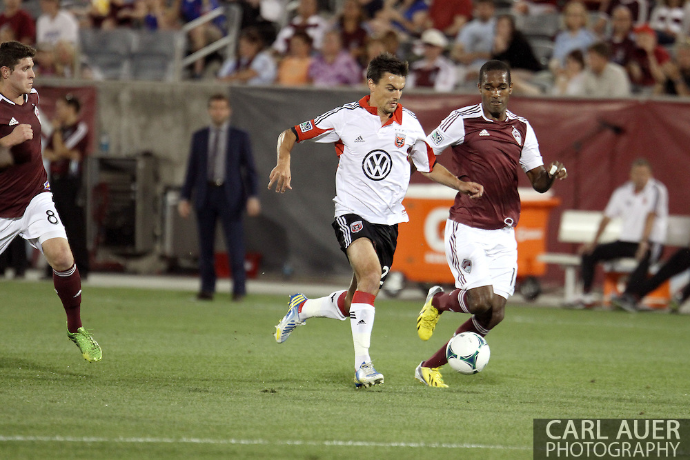 July 7th, 2013 - D.C. United defender/midfielder Alain Rochat (25) attempts to out run Colorado Rapids midfielder Atiba Harris (16) to get to the ball first in the second half of action in the Major League Soccer match between D.C. United and the Colorado Rapids at Dick's Sporting Goods Park in Commerce City, CO
