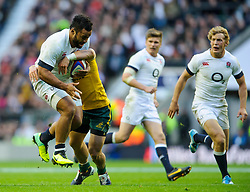 England Number 8 (#8) Billy Vunipola (London Wasps)  is tackled by Australia Fly-Half (#10) Quade Cooper (Queensland Reds) during the second half of the match - Photo mandatory by-line: Rogan Thomson/JMP - Tel: Mobile: 07966 386802 02/11/2013 - SPORT - RUGBY UNION -  Twickenham Stadium, London - England v Australia - Cook Cup - QBE Autumn Internationals.