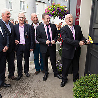 Emelyn Heaps, PJ Keogh, Paul Walsh, Cllr Paul Murphy, Joe Carey, TD, and Micheal Ring, TD, Junior Minister for Sport, cutting the ribbon at the Official opening of 'The Castle', Antique, Arts & Craft Centre in Clarecastle