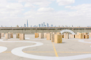 Blocks of wood used as bar stools interspersed throughout the artwork AGORA, Richard Wentworth's newly commissioned piece painted in an abstract design that covers the entire floor area of a disused car park roof in Peckham. The title, designating an open assembly space in Ancient Greek, shares an etymological root with 'gregarious', highlighting the work's ambition to bring the space to life for the many visitors who will experience it during the summer.                                   BOLD TENDENCIES, a not-for-profit commissioning organisation founded in 2007 transformed a disused multi-storey car park in Peckham through its summer programme of visual art, architecture, music, theatre, film and literature.