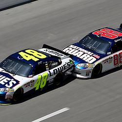 April 17, 2011; Talladega, AL, USA; NASCAR Sprint Cup Series driver Dale Earnhardt Jr. (88) drafts Jimmie Johnson (48) during the Aarons 499 at Talladega Superspeedway.   Mandatory Credit: Derick E. Hingle