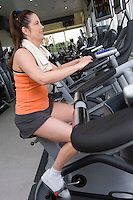 Woman Working Out on Exercise Bicycle in Gym