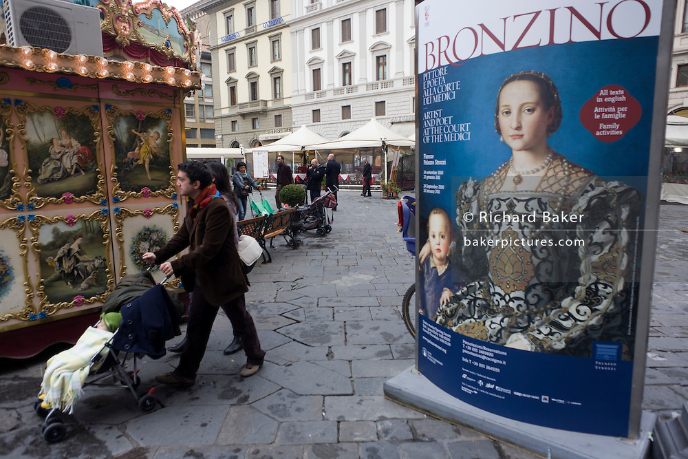 Modern Italian family and Agnolo de Cosimo Bronzino's painting of the Medici Eleanora of Toledo and son Giovanni C1545. The poster advertises the art exhibition by the celebrated painter Agnolo de Cosimo Bronzino. Agnolo de Cosimo Bronzino's painting of the Medici Eleanora of Toledo and son Giovanni C1545. Eleonora di Toledo (1522 - 1562), the daughter of Don Pedro Álvarez de Toledo, the Spanish viceroy of Naples. Eleonora was a patron of the new Jesuit order, and her private chapel in the Palazzo Vecchio  was decorated by Bronzino, who had originally arrived in Florence to provide festive decor for her wedding. She died, with her sons Giovanni and Garzia, in 1562, when she was only forty; all three of them were struck down by malaria while travelling to Pisa.