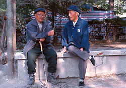 CHINA BEIJING APR99 -  Two elderly Chinse men sit and gossip in a park near Beihai. jre/Photo by Jiri Rezac
