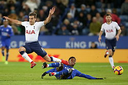 Tottenham Hotspur's Harry Winks (left) and Leicester City's Demarai Gray battle for the ball during the Premier League match at the King Power Stadium, Leicester.