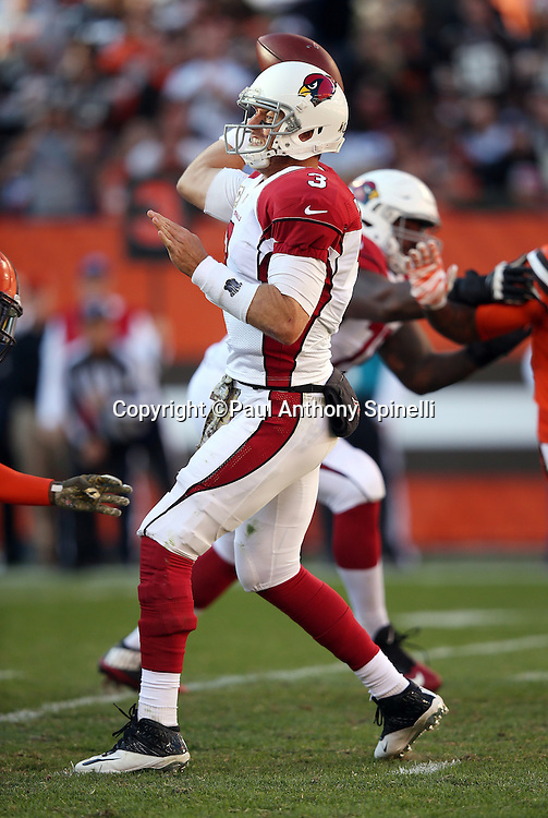 Arizona Cardinals quarterback Carson Palmer (3) throws a pass during the 2015 week 8 regular season NFL football game against the Cleveland Browns on Sunday, Nov. 1, 2015 in Cleveland. The Cardinals won the game 34-20. (©Paul Anthony Spinelli)