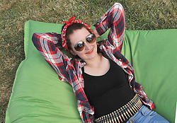 Music fans Roisin McBride from Dublin basking in the sunshine at the Westport Festival.<br /> Pic Conor McKeown