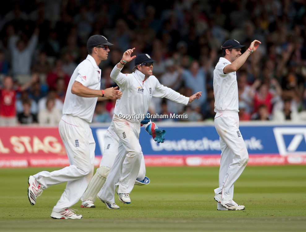 Celebrations as Mahendra Singh Dhoni edges Chris Tremlett and is caught by wicket keeper Matt Prior during the first npower Test Match between England and India at Lord's Cricket Ground, London.  Photo: Graham Morris (Tel: +44(0)20 8969 4192 Email: sales@cricketpix.com) 25/07/11