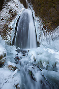 "After several days of below-freezing temperatures, Wahkeena Falls is surrounded by ice. Wahkeena Falls is located in Oregon's Columbia River Gorge and drops 242 feet (74 meters) in several tiers. Wahkeena means ""most beautiful"" in Yakama Indian."