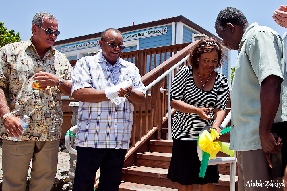 Ribbon cutting ceremony.  (L-R) Franke Hoheb, Chief of Staff for Sen. Celestino White;  Honorable St. Claire N. Williams, Commissioner; Ms. Donna Berry, Coki Point Beach Facility Vendor, Sun Seekers Beach Rentals; and Lt. Gov. Gregory R. Francis.  Department of Housing, Parks & Recreation, Coki Point Beach Facility Rededication Ceremony.  2 August 2012.  © Aisha-Zakiya Boyd
