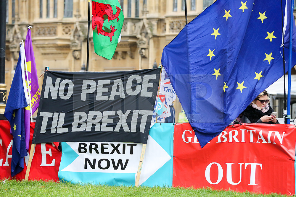© Licensed to London News Pictures. 23/10/2019. London, UK. Pro-Brexit banners are seen outside The Houses of Parliament in Westminster. On Tuesday 22 October 2019, MPs rejected Prime Minister BORIS JOHNSON?S fast-track timetable for ratifying the Brexit deal and the government ?paused? the parliamentary process ? almost certainly ending any prospect of Brexit on 31 October.Photo credit: Dinendra Haria/LNP