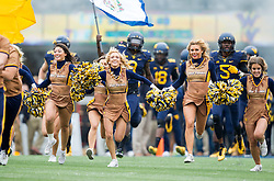 Nov 7, 2015; Morgantown, WV, USA; West Virginia Mountaineers cheerleaders lead the team onto the field before their game against the Texas Tech Red Raiders at Milan Puskar Stadium. Mandatory Credit: Ben Queen-USA TODAY Sports