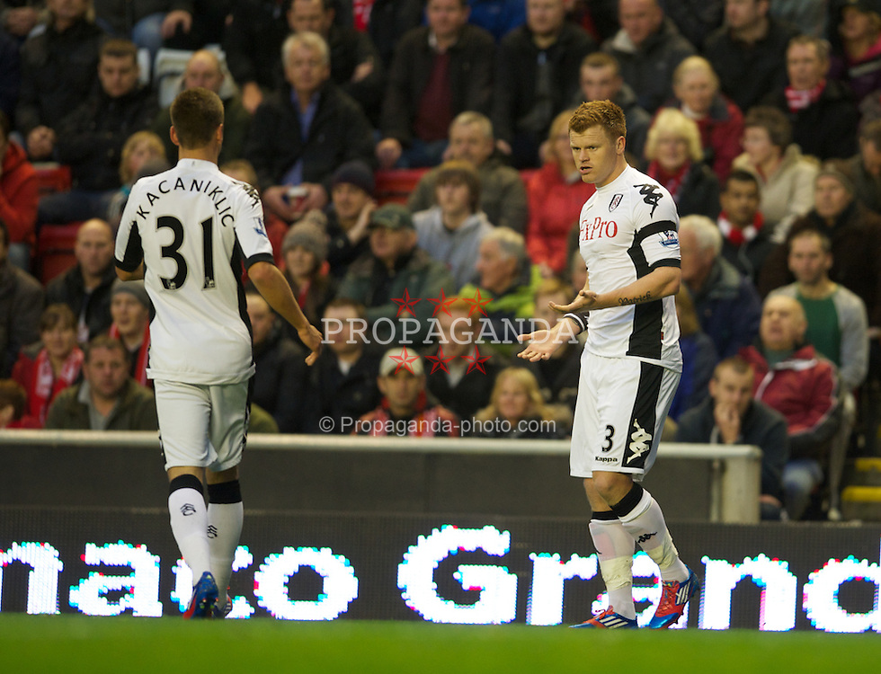 LIVERPOOL, ENGLAND - Tuesday, May 1, 2012: Fulham's John Arne Riise celebrates after Liverpool score an own goal during the Premiership match at Anfield. (Pic by David Rawcliffe/Propaganda)