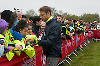 Formula 1 driver Jenson Button signs autographs at the celebrity start of the Virgin Money London Marathon 2015, Sunday 26th April 2015<br /> <br /> Roger Allen for Virgin Money London Marathon<br /> <br /> For more information please contact Penny Dain at pennyd@london-marathon.co.uk