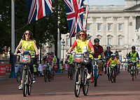 Early riders cycle down The Mall as part of the Prudential RideLondon FreeCycle 29/07/2017<br />