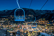 Lift 1A on Aspen Mountain, under the light of a full moon, with the town of Aspen in the background.