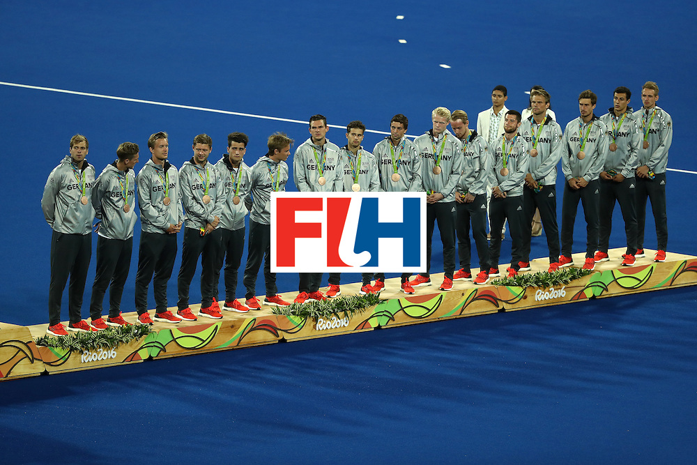 RIO DE JANEIRO, BRAZIL - AUGUST 18:  Bronze medalists Team Germany pose on the podium during the medal ceremony for the Men's Hockey Gold Medal match between Belgium and Argentina on Day 13 of the Rio 2016 Olympic Games at Olympic Hockey Centre on August 18, 2016 in Rio de Janeiro, Brazil.  (Photo by Sean M. Haffey/Getty Images)