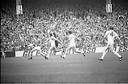 The All Ireland Senior Football Final.1982.19.09.1982.09.19.1982.19th September 1982..The senior final was contested between Offaly and Kerry. Offaly won the title by the narrowest of margins 1.15 to 17 points..Kerry forward Michael Sheehy gathers the ball as the Offaly backs close in.