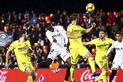 January 26, 2019 - Valencia, Spain - Mouctar Diakhaby of Valencia CF (C) shoot to goal during  spanish La Liga match between Valencia CF vs Villarreal CF at Mestalla Stadium on Jaunary  26, 2019. (Credit Image: © Jose Miguel Fernandez/NurPhoto via ZUMA Press)