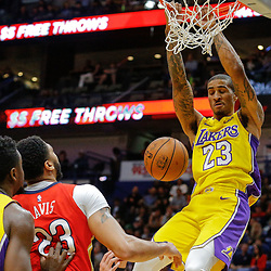 Feb 14, 2018; New Orleans, LA, USA; Los Angeles Lakers guard Gary Payton II (23) dunks over New Orleans Pelicans forward Anthony Davis (23) during the second quarter at the Smoothie King Center. Mandatory Credit: Derick E. Hingle-USA TODAY Sports