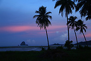 The afterglow of dusk and the islands of Ko Rang Nok and Koh Luk Ko off the coast of Laem Had Beach, Koh Yao Yai, Phang Nga, Thailand.