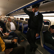 Victor Bennett, conductor, chats with commuters on the VRE bound for Union Station.
