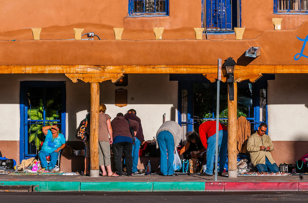 Native Americans selling jewelry, beadwork and pottery under a portal along Old Town Plaza, Albuquerque, New Mexico USA