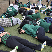 Loyola rugby players rest between matches during the Four Leaf 15's Club Rugby Tournament at Randall's Island New York. The tournament included 70 teams in 6 divisions, organized by the New York City Village Lions RFC. Randall's Island, New York, USA. 23rd March. Photo Tim Clayton