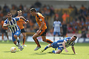 Wolverhampton Wanderers midfielder Conor Coady wins possession against Brighton winger, Jamie Murphy during the Sky Bet Championship match between Wolverhampton Wanderers and Brighton and Hove Albion at Molineux, Wolverhampton, England on 19 September 2015.