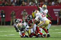 20 January 2013: Cornerback (29) Chris Culliver of the San Francisco 49ers intercepts a pass and is tackled by the Atlanta Falcons during the second half of the 49ers 28-24 victory over the Falcons in the NFC Championship Game at the Georgia Dome in Atlanta, GA.