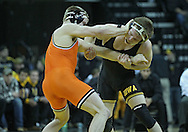 January 07, 2011: Oklahoma State's Chris Perry tries to hold off Iowa's Ethen Lofthouse during the 174-pound bout in the NCAA wrestling dual between the Oklahoma State Cowboys and the Iowa Hawkeyes at Carver-Hawkeye Arena in Iowa City, Iowa on Saturday, January 7, 2012. Perry won 3-2.