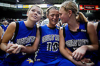 JEROME A. POLLOS/Press..Coeur d'Alene High's Natalie Stewart, left, and Dayna Drager, right, comfort their teammate, Kama Griffitts, as she's overwhelmed with emotion after their teammate, Whitney Heleker, made a game winning shot in overtime during the 5A state championship game Saturday at the Idaho Center in Nampa.