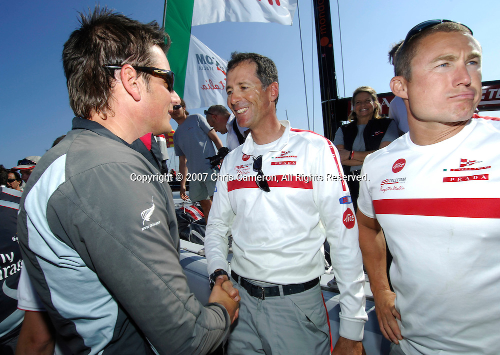 Emirates Team New Zealand helmsman Dean Barker shakes hands with Luna Rossa skipper Francesco de Angelis when the two teams meet on the dock after the final race of the Louis Vuitton Cup 2007. <br /> Valencia, Spain<br /> Wednesday 6 June 2007<br /> Photo: Chris Cameron/PHOTOSPORT