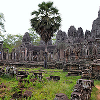 Layout of Bayon in Angkor Archaeological Park, Cambodia<br /> Bayon was structured as an isolated mountain in the center of Angkor Thom. It does not have its own surrounding wall but shares those of the former capital city. The footprint measures 524 by 460 feet. At the corners are entrance gates with attached pavilions. Inside of the temple are three concentric enclosures. The first two are galleried while the third sits on a high platform. This first enclosure contains most of the famous face prasats plus the inner sanctuary. The central tower measures 141 feet. Within the complex are several chambers, vestibules and libraries. There are also four sanctuaries. Each one is dedicated to either a Hindu or Buddhist god.