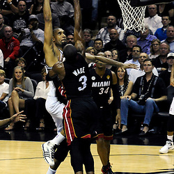 Jun 13, 2013; San Antonio, TX, USA; San Antonio Spurs power forward Tim Duncan (21) shoots against Miami Heat shooting guard Dwyane Wade (3) during the second quarter of game four of the 2013 NBA Finals at the AT&T Center. Mandatory Credit: Derick E. Hingle-USA TODAY Sports