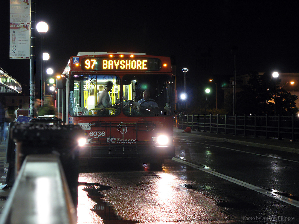 June 5, 2008 - Ottawa, ON. OC Transpo bus route 97 leaving the stop in downtown Ottawa, ON close to midnight. OC Transpo is a bus servicing business in Ottawa, ON, Canada.