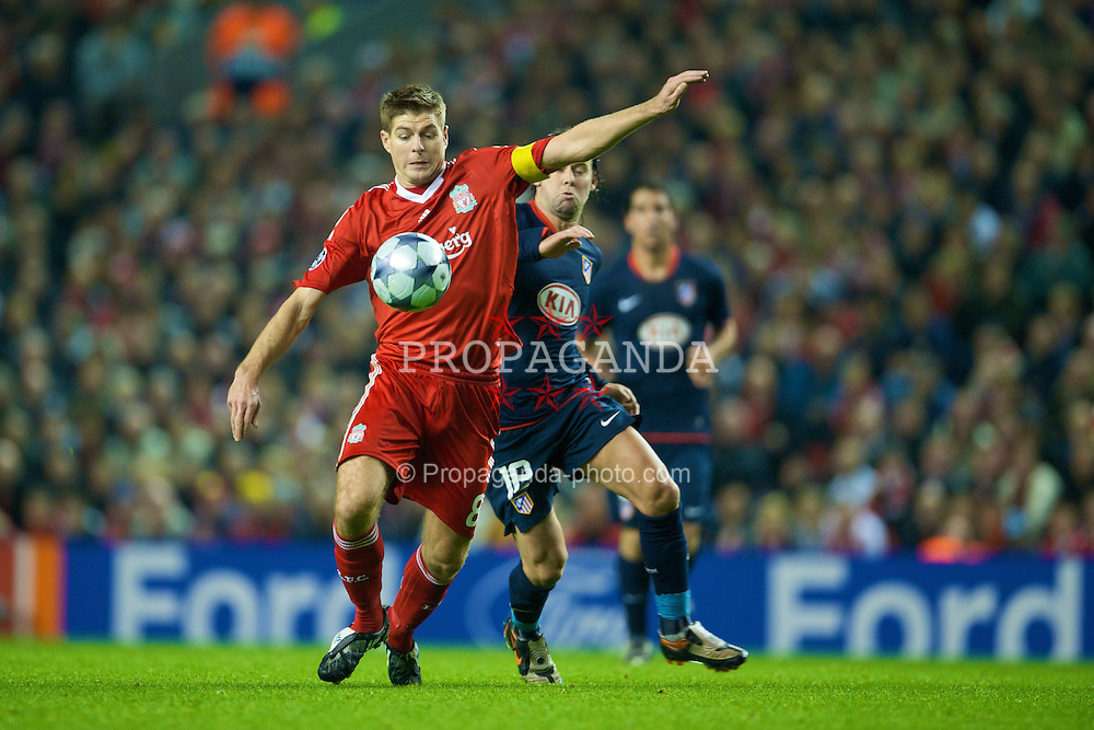 LIVERPOOL, ENGLAND - Tuesday, November 4, 2008: Liverpool's captain Steven Gerrard MBE fires in a shot against Club Atletico de Madrid during the UEFA Champions League Group D match at Anfield. (Photo by David Rawcliffe/Propaganda)