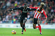 Liverpool forward Sadio Mane (#19) takes on Sunderland midfielder Didier Ndong (#17) during the Premier League match between Sunderland and Liverpool at the Stadium Of Light, Sunderland, England on 2 January 2017. Photo by Craig Doyle.