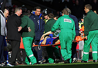 A Concerned Alex Ferguson Manager looks at the seriously injured Alan Smith as he's stretchered off<br />Manchester United 2005/06<br />Liverpool V Manchester United 18/02/06<br />The F/A Cup 5th Round<br />Photo Robin Parker Fotosports International