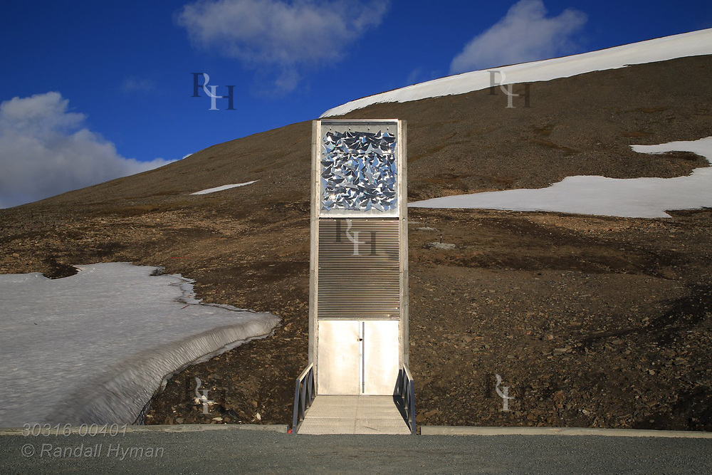 Global Seed Vault looms from rocky hillside in mid summer in Longyearbyen on Spitsbergen island, Svalbard, Norway.
