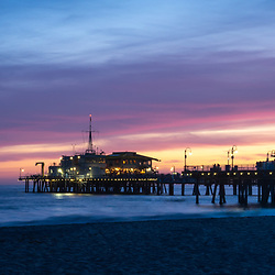 Santa Monica Pier sunset panorama photography. Santa Monica Pier is along the Pacific Ocean in Southern California in the United States. Panoramic photo ratio is 1:3. Copyright ⓒ 2017 Paul Velgos with All Rights Reserved.