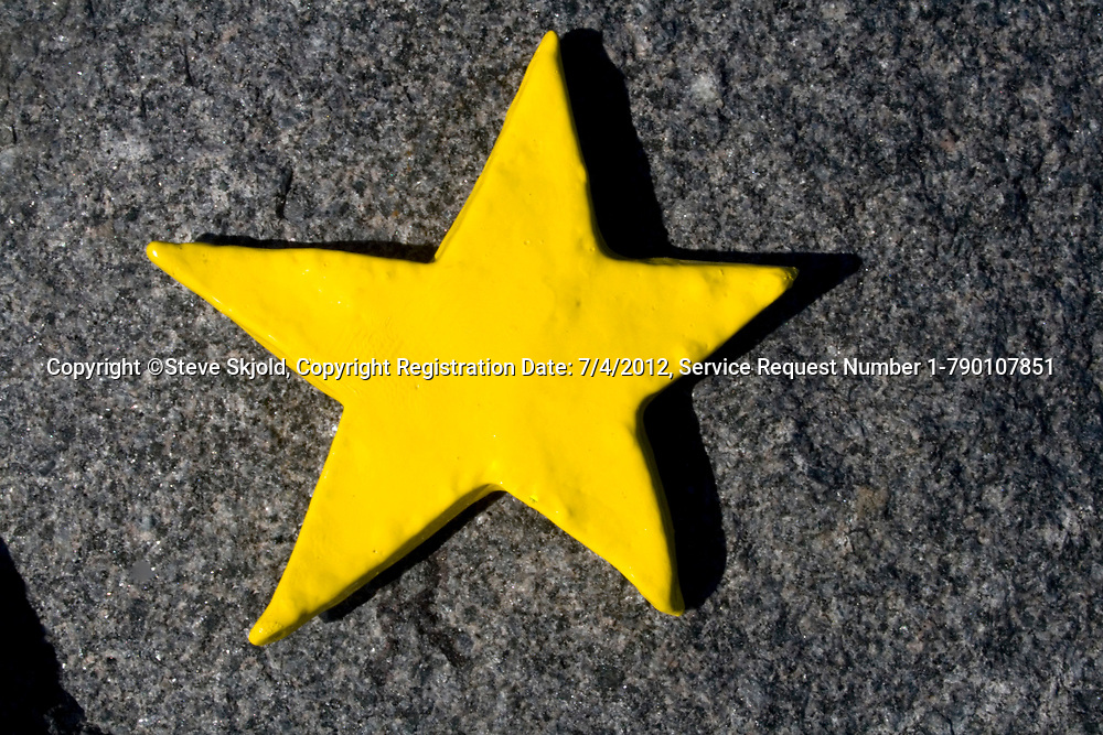 Yellow star on rock exhibited in an outside art gallery. Franconia Sculpture Park Franconia Minnesota MN USA