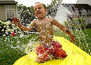 A young boy cools off from the summer heat.