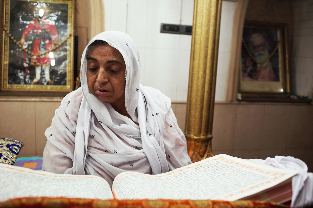 A Hindu woman prays at Gurdwar Hindu temple, Sukkur, Sindh, Pakistan on March 22, 2012. A rise in in reports of forced conversion of Hindu girls to Islam in provinces in Pakistan has gained prominence within the political, media, religious and social domains with the case of a 21 year old woman Rinkle Kumari. On February 24, 2012 her family reported to police of Ghotki district, Sindh province that she had been abducted by armed men from the family home in the village of Mirpur Mathelo. it is then alleged by the family and broadrer hindu community that she was forced to convert to Islam and marry Syed Naveed Shah, a neighbour of the girl within their village. Complications with court hearings for the case, perceptions by the Muslim community that the police sided with the Muslim community when dealing with issue and the politicisation of the case by a Pakistan Peoples Party Member for National Assembly Mian Abdul Haq alias Mian Mitho has led to a hearing being called in the Supreme Court, Islamabad, Pakistan on March 26, 2012. The hearing will hopefully ascertain whether the girl was abducted or in fact left with Syed Naveed Shah of her own free will.
